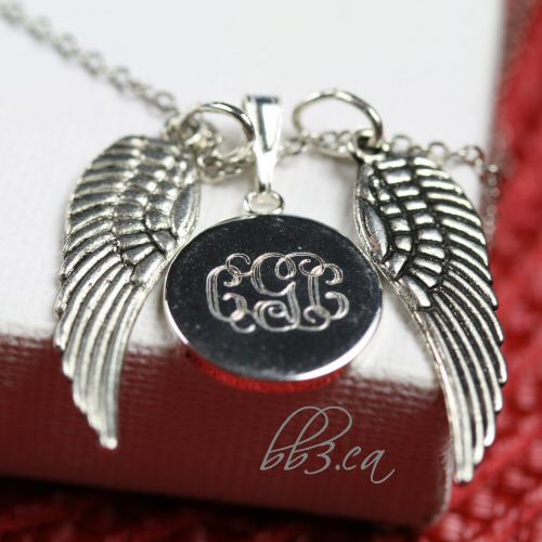 """Wings"" memorial necklace manually engraved with my mom's initials"