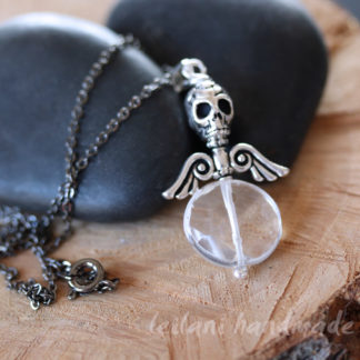 crystal quartz faceted coin with skull and wings pendant