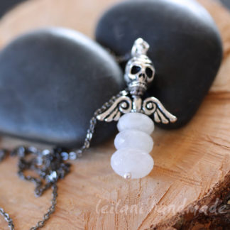 faceted moonstone skull and wings pendant