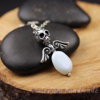 aquamarine stone skull and wings pendant