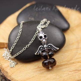 skull and wings pendant featuring smokey quartz gemstone