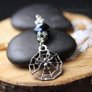 spider sitting on web pendant necklace