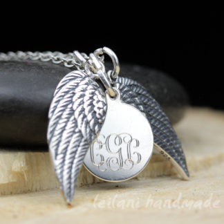 pair of sterling silver wings with monogram charm necklace