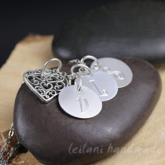 filigree heart charm with enhraved letter charms necklace