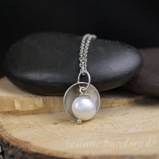 pearl necklace wirh hand domed antique silver disk