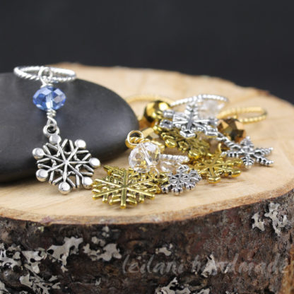 snowflake charm knitting stitch marker set silver and gold