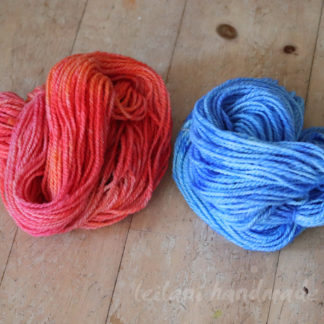 Handspun Corriedale yarn set kettle dyed hues of blue and soft coral