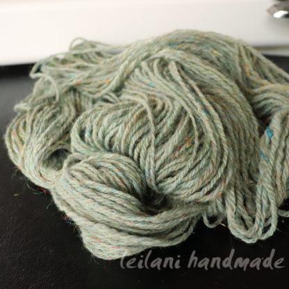 close up pic of moss green alpaca yarn