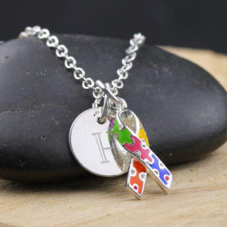 Enameled puzzle piece sterling silver necklace