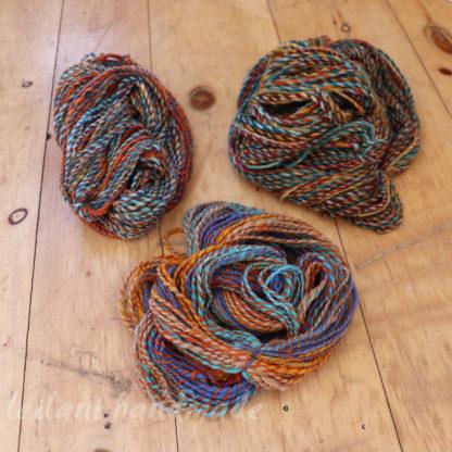 handspun yarn bundle rainbow with orange accent
