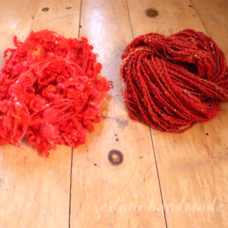 art yarn bundle orange and red